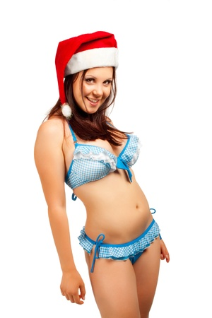 Seductive funny Santa helper in blue bikini isolated over white background photo