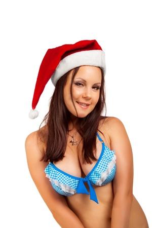 Portrait of seductive Santa helper in bikini isolated over white. photo