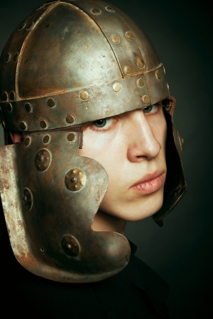 Portrait of serious man in roman helmet over dark background Stock Photo - 17480203