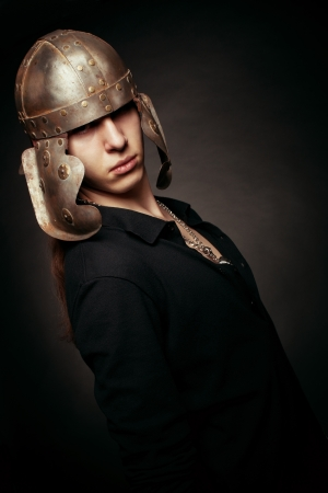 Portrait of serious man in roman helmet over dark Stock Photo - 17480197