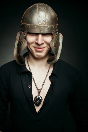 Funny young man in roman helmet over dark background Stock Photo - 17480200
