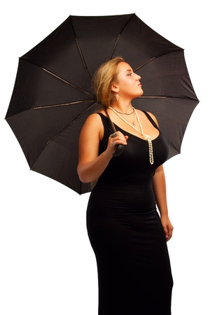 Seductive lady in black with umbrella isolated over white background Stock Photo - 17601652