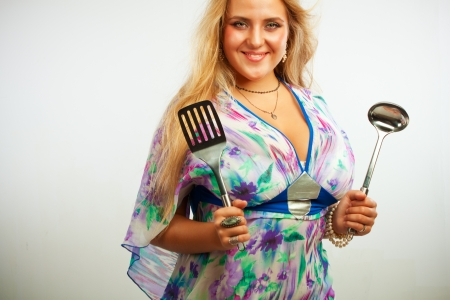 Seductive young woman with spatula and ladle Stock Photo - 17605551