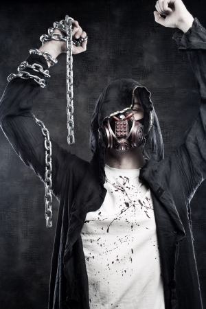 Portrait of strong terrible warrior with chains  in respirator Stock Photo - 17890840