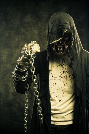 Merciless fighter of cruel post apocalyptic world with chains photo