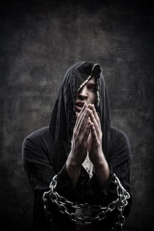 doomed: Post apocalyptic prophet praying over grange background