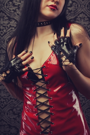 Woman in sexy red latex costume photo