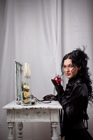Elegant gothic lady in black dress with perfume in a hand Stock Photo - 19857542