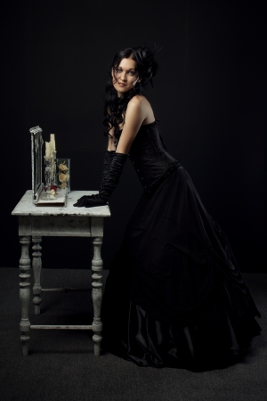 bodice: Young old-fashioned actress over black background