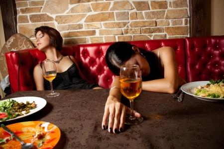 drunk girl: Drunken women after party at a restaurant
