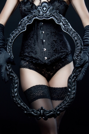 lingerie model: Sexy slim girl in black underwear holding frame Stock Photo