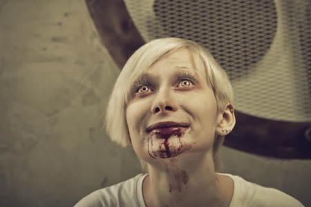 delirium: Pretty blonde girl with bloody mouth and red eyes