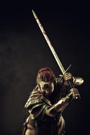 Angry mercenary ready to fight  Dark background