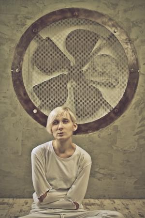 Pretty sad girl sitting on floor in a mental hospital  photo