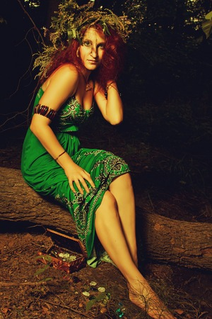 Pretty redhead slavonic witch in the forest