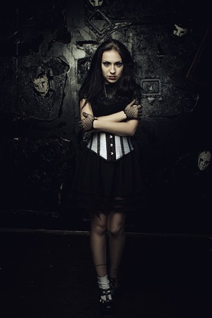 grunged: Pretty gothic girl with black eyes over grunged background Stock Photo