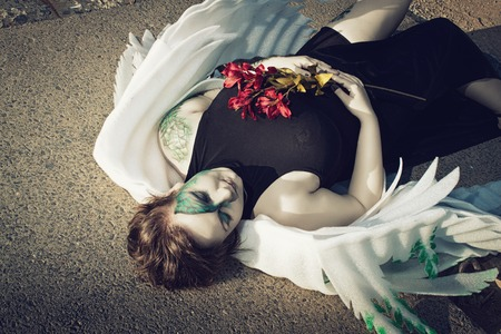 corpse flower: Dead pretty angel laying on the ground with flowers Stock Photo