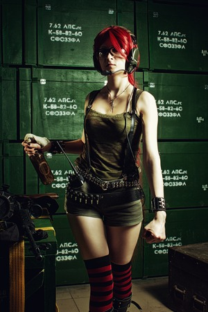 molotov: Attractive redhead girl with molotov cocktail posing in a vault