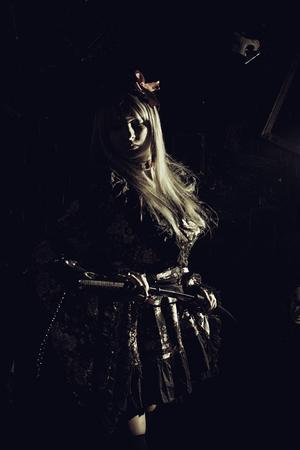 female assassin: Pretty samurai girl with katana over dark background
