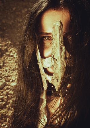 wasteland: Pretty girl in iron mask over wasteland