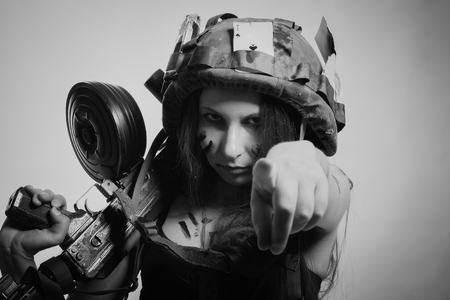 Serious military girl pointing finger at camera