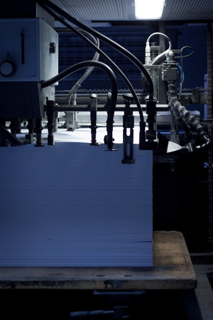 Stack of blank  paper in an offset printing machine