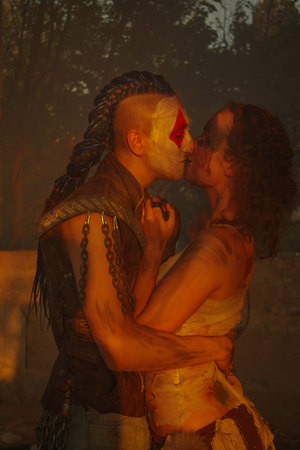 Brutal raider kissing with his woman in the sunshine