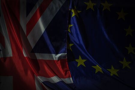 Closeup of the United Kingdom flag and the European Union flag. Brexit concept
