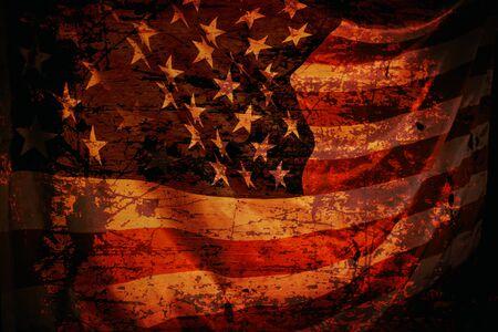 Closeup of grunge aged American flag over dark