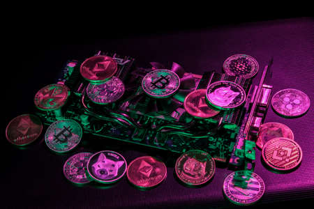 Pile of cryptocurrencies on videocard in neon light