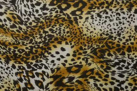 spotted: Background from leopard spotted fabric.