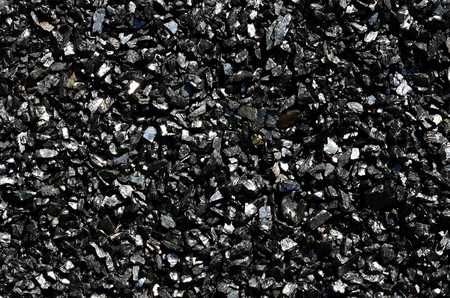 Background of fine shiny charcoal of anthracite coal close-up.