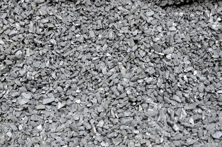 미세한 석탄은 흩어져 먼지로 덮여있다. 스톡 콘텐츠
