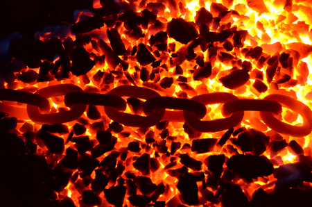 The links of a red-hot chain lying on a burning coal anthracite.