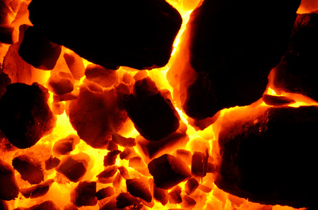 Background of burning and flaring pieces of coal anthracite of different fractions. Stock fotó