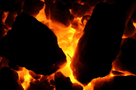 Huge pieces of flaming coal anthracite, like a background.