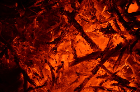 Burning and smoldering wooden branches, like a background. Stock Photo