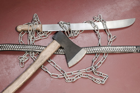 Machete, chain, ax and belt with metal inserts-an attribute of a metal player.