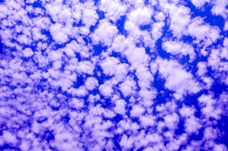 Background from a bright blue sky with shallow clouds in computer processing.