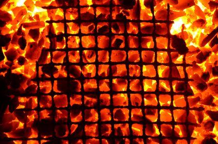 Bright orange background consists of burning coals and iron mesh.