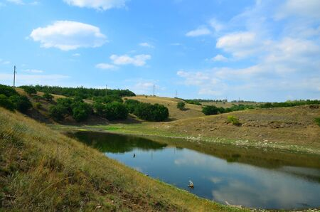 Artificial lake with a reduced water level.