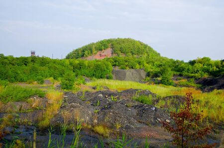 The industrial landscape consists of a heaps of piles, copra mines and black rock.