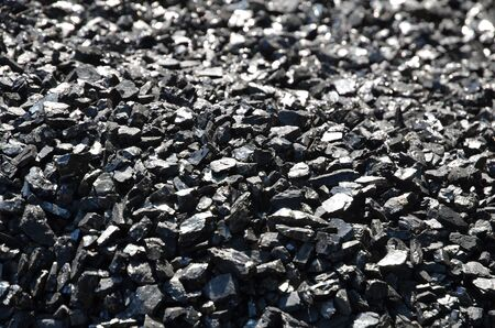 Coal anthracite enriched with a fine fraction lies in bulk.