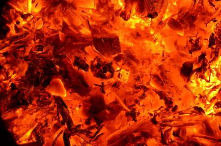 Burning coal mixed with wood as a bright background. Zdjęcie Seryjne