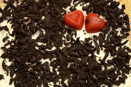 The surface of the cake with the image of two hearts as a background.