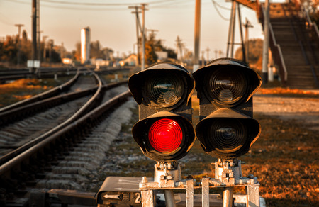 traffic controller: Traffic light shows red signal on railway. Ukrainian railways.