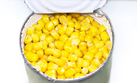 Canned sweet corn in a tin can. Top view, iron package