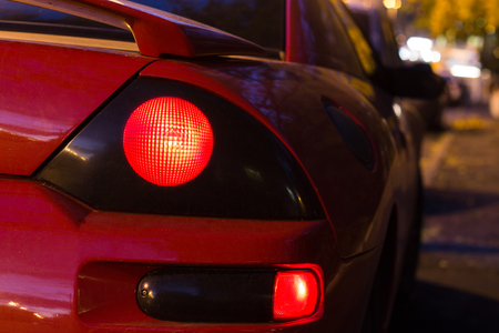 sportcar: Red sports car glowing Back Lights