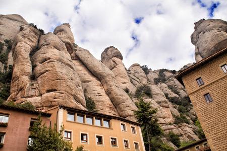 Santa Maria de Montserrat Abbey in Monistrol de Montserrat, Catalonia, Spain. Famous for the Virgin of Montserrat. View to mountains.
