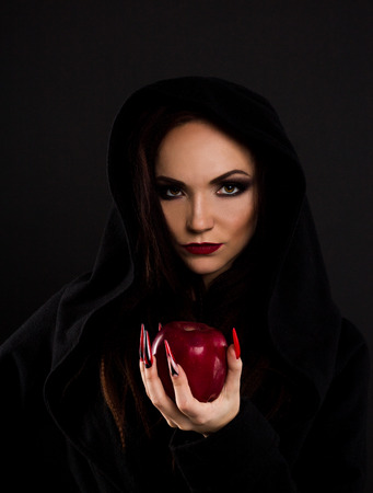 Stepmother witch gives poisoned red apple